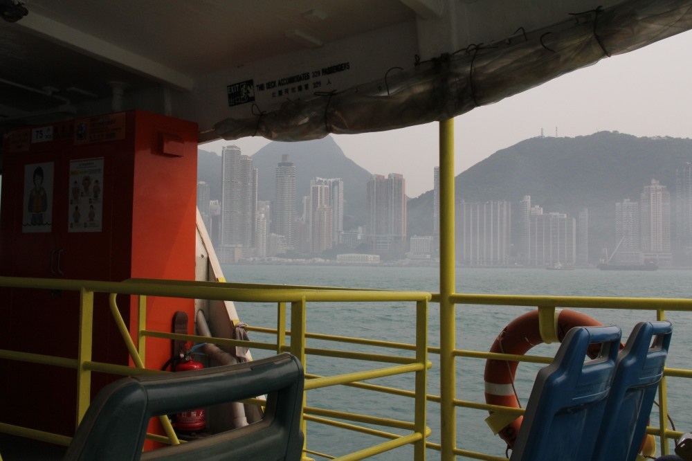 Pulling into Victoria Harbor, Hong Kong. Photo (c) Stacy Libokmeto