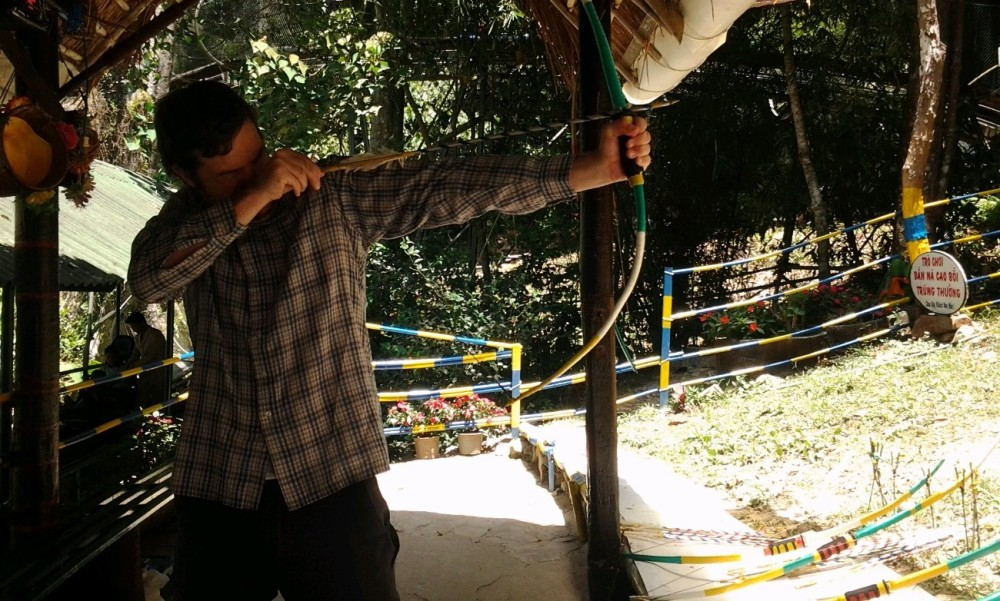 Stax helpfully captures my archery fail on her phone. Image (c) 2014 Stacy Libokmeto
