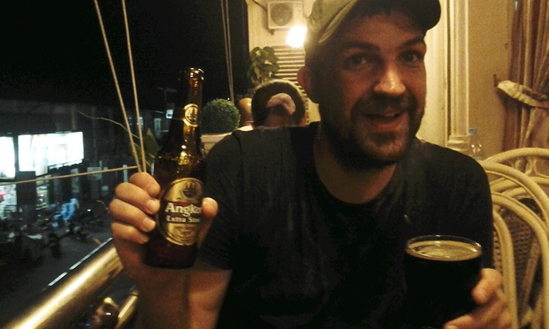 Beej is so happy to find good dark beer in Cambodia that he's close to tears. Photo (c) 2014 Stacy Libokmeto